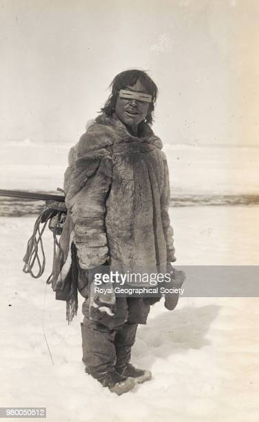 Caribou Eskimo from Eskimo Point wearing snow glasses of wood Northwest Territories Canada 1921