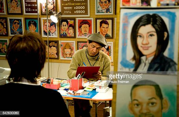 A caricature artist works in the Sunshine City building in Tokyo Japan