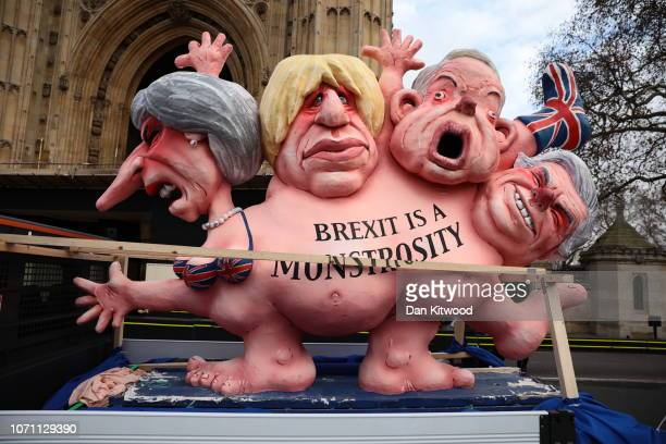 A caricature depicting Theresa May Boris Johnson Michael Gove and David Davis with the words 'Brexit is a monstrosity' is displayed outside the...