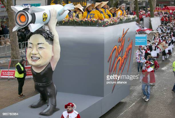 A caricature float featuring Kim Jongun the leader of North Korea takes part in the Rosenmontag  carnival procession in Cologne Germany 12 Febraury...