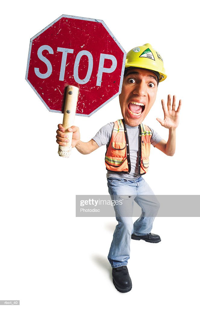 caricature of a caucasian construction worker as he holds up a stop sign : Stockfoto