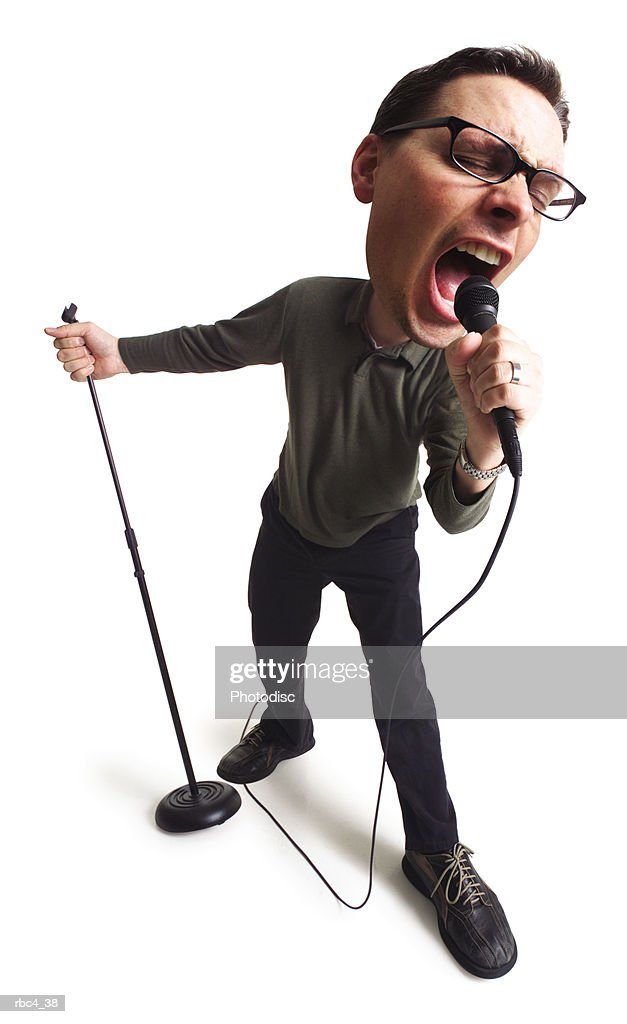 caricature of a caucasian male singer as he grabs the microphone and sings to his hearts delight : Stockfoto
