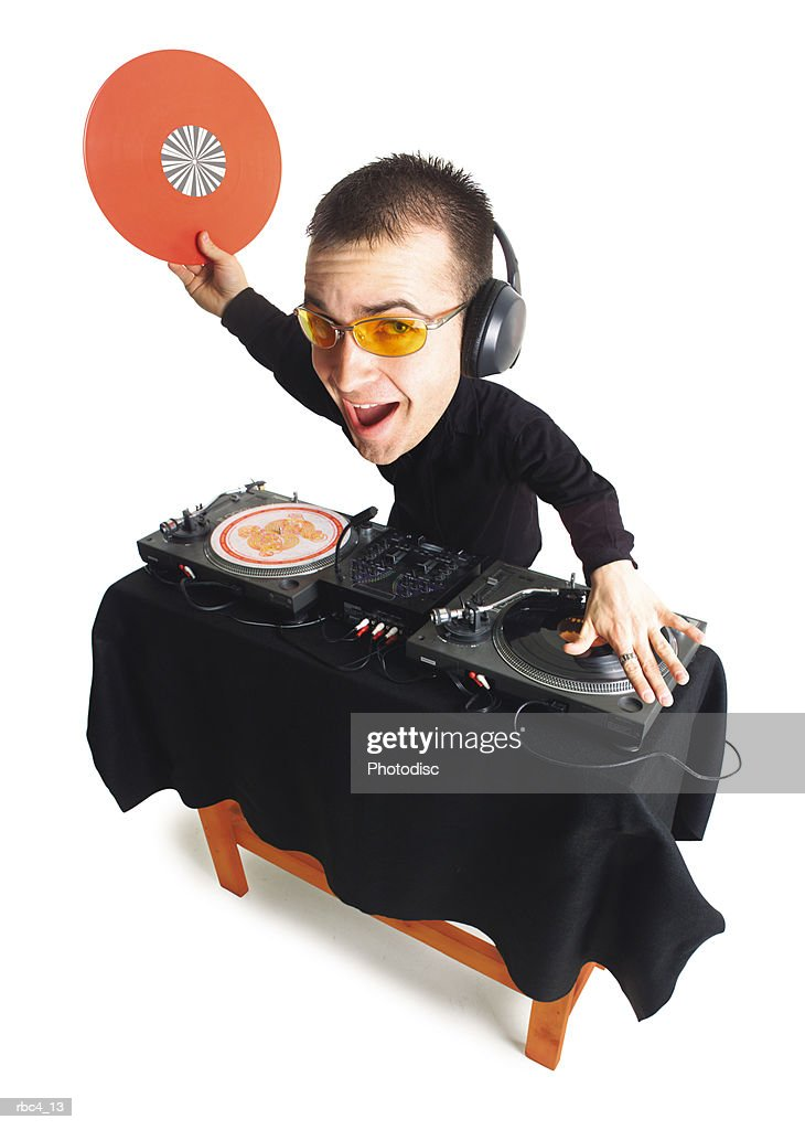 caricature of a young caucasian dj as he spins his records : Stockfoto