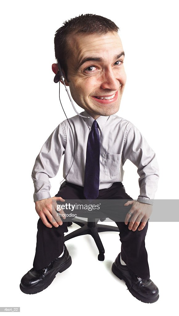 caricature of a young goofy male telemarketer as he flashes a cheesy smile : Stock Photo