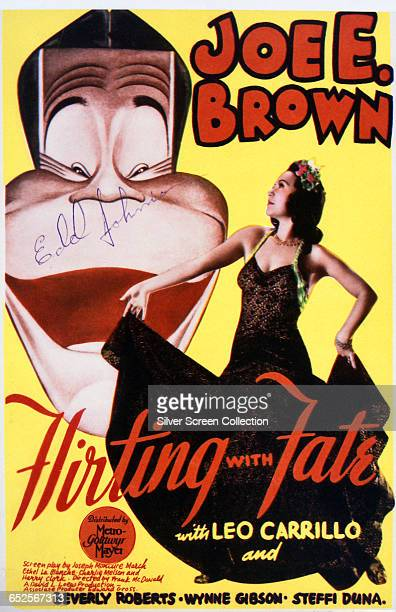 A caricature of American actor Joe E Brown as Dan Dixon alongside actress Steffi Duna on a poster for the MGM comedy film 'Flirting with Fate'...