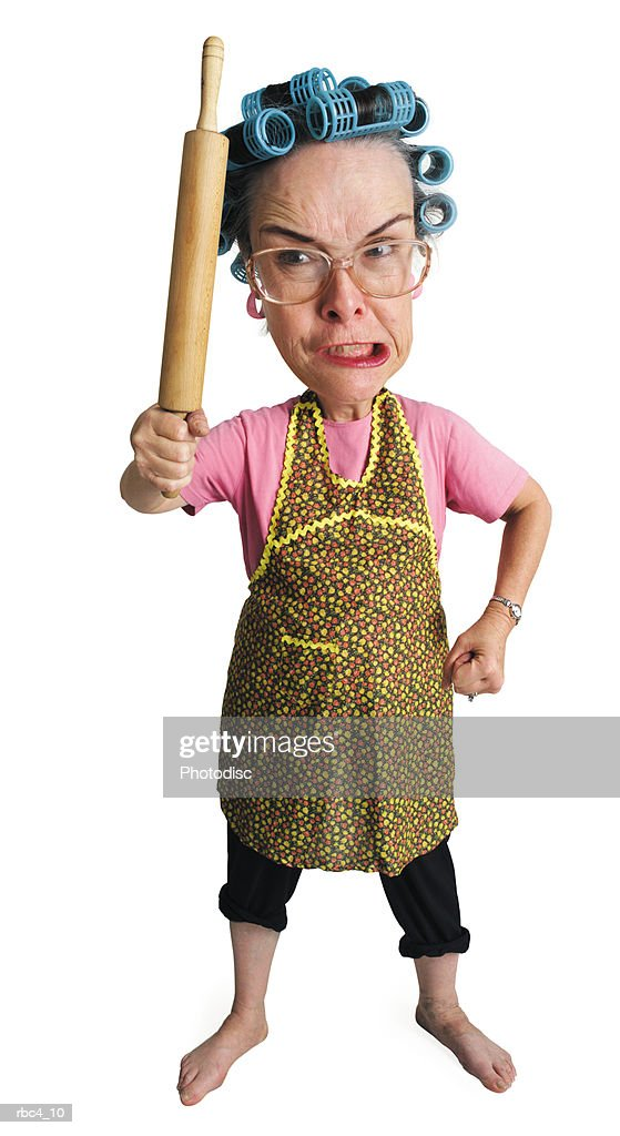 caricature of an elderly angry caucasain woman as she threatens the world with her rolling pin : Stockfoto
