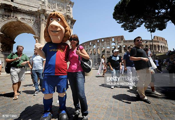 A caricature of Barcelona captain Carles Puyol poses with tourists in the centre of Rome on May 26 2009 on the eve of the Champions League final...