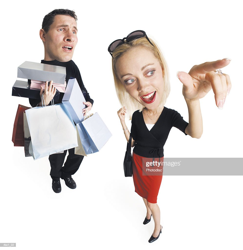 Caricature young caucasian couple shopping the man carries many bags packages as blonde woman points : Stock Photo