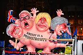 caricatures conservative politicians are driven past