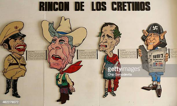 Caricatures of former Cuban President Fulgencio Batista and former US presidents Ronald Reagan George HW Bush and George W Bush hang on the wall of...