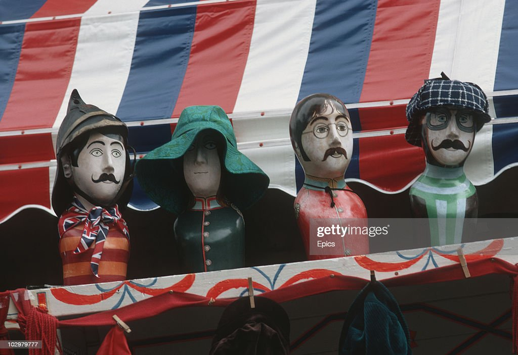 Caricatures of the Beatles for sale on a market stall on Portobello Road, London, August 1970. The line-up includes Paul McCartney and John Lennon.