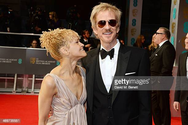Caridad Rivera and Matthew Modine attend the EE British Academy Film Awards 2014 at The Royal Opera House on February 16 2014 in London England