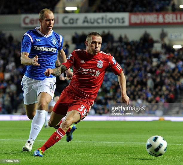 Carig Bellamy of Liverpool competes with Steven Whittaker of Rangers during a friendly between Rangers and Liverpool at Ibrox Stadium on October 18...
