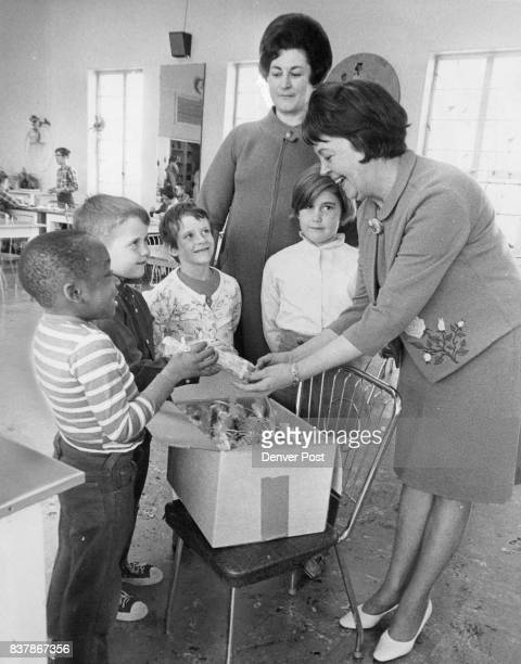 Carih Children Get Candy Mrs William McNichols right distributes candy to from ft Louie Hawkins Tucson Ariz Andy Cooks New York City Lisa Myers...