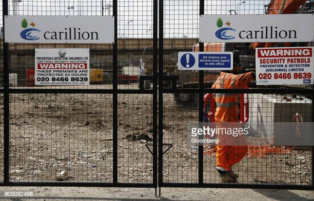 Carillion Plc company logos sit on the gates of a construction site for new apartment blocks built by Carillion Plc in the Canning Town district of...