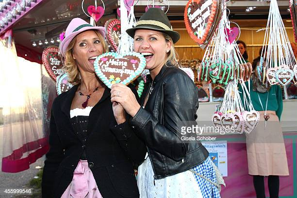 Carin C Tietze and Jessica Boehrs attend the 'GoldStar TV Wiesn' during Oktoberfest at Weinzelt Theresienwiese on September 23 2014 in Munich Germany