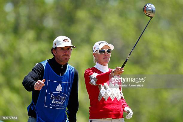 Carin Koch of Sweden is helped by her caddie prior to a tee shot on the 12th hole during the third round of the SemGroup Championship presented by...