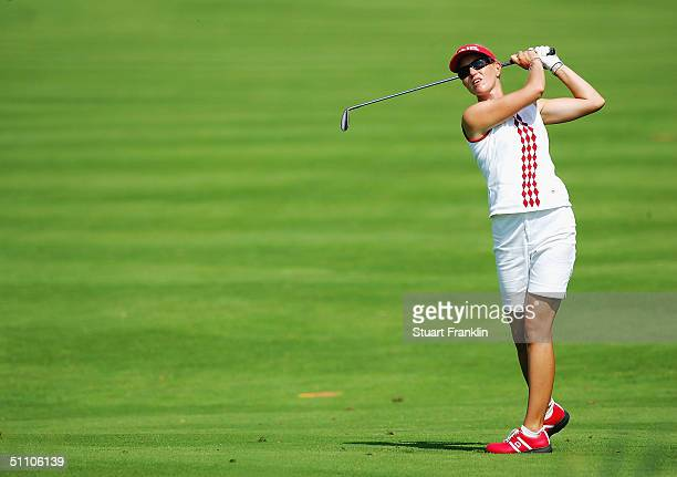 Carin Koch of Sweden plays her approach shot on the 18th hole during the second round at The Evian Masters at Evian Golf Club on July 22 2004 in...