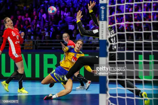 Carin Stromberg of Sweden is shooting the ball against Adrianna Placzek of Poland during the EHF Women's Euro match between Sweden and Poland on...