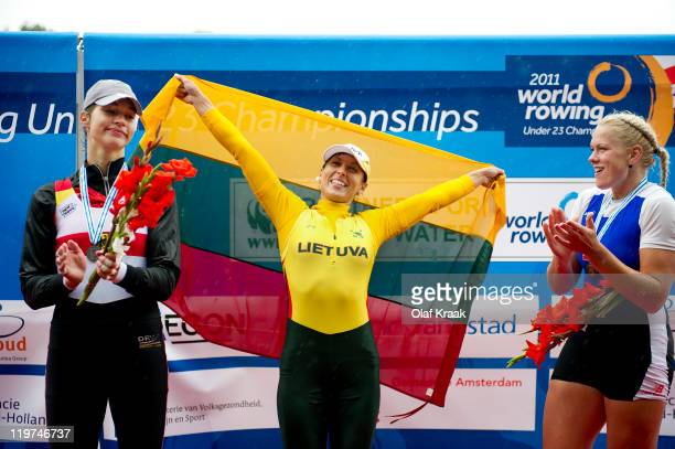 Carina Baer of Germany Donata Vistartaite of Lithuania and Kaisa Pajusalu of Estonia celebrate Silver Gold and Bronze in Women's Single Sculls during...