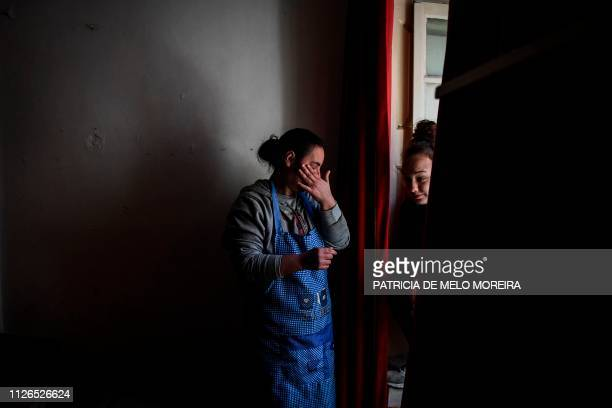 Carina de Sousa 36 years old cries as she explains to her daughter Ana Raquel R 17 years old her financial situation at their rented house in...
