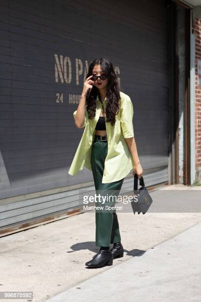 Carina is seen on the street during Men's New York Fashion Week wearing JW Anderson bag thrifted outfit on July 11 2018 in New York City