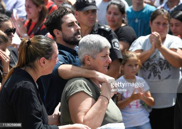 Carina Mercedes Taffarel mother of Emiliano Sala looks at the coffin after a vigil as she is comforted by relatives at Sala's boyhood club San Martin...