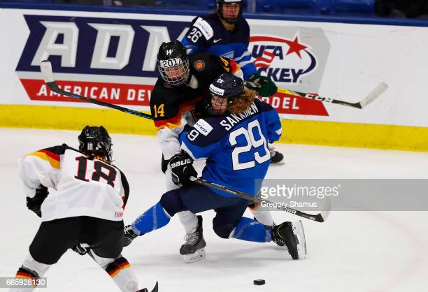 Carina Strobel of Germany battles for the puck with Sara Sakkinen of Finland during the second period in the bronze medal game at the 2017 IIHF...