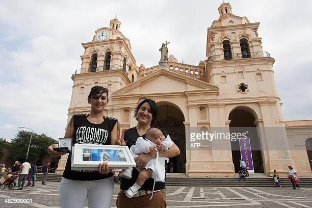 Carina Villarroel and her couple Soledad Ortiz pose with their twomonth old daughter Umma Azul Villarroel after the latter's baptism ceremony at the...