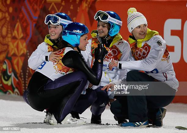 Carina Vogt of Germany is congratulated for winning the gold medal by Ulrike Graessler Katharina Althaus and Gianina Ernst of Germany after the...