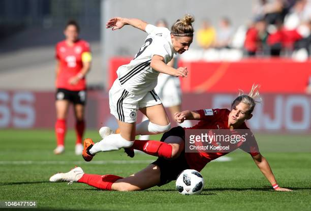 Carina Wenninger of Austria Challenges Svenja Huth of Germany during the International friendly match between Germany Women and Austria Women at...