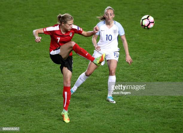 Carina Wenninger of Austria clears from Toni Duggan of England during the Women's International Friendly match between England and Austria at Stadium...