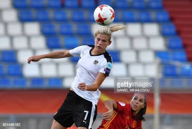 Carina Wenninger of Austria vies with Maria Paz of Spain during the UEFA Women's Euro 2017 quarterfinal football match between Austria and Spain at...
