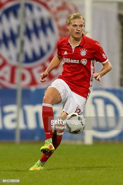 Carina Wenninger of Bayern Muenchen controls the ball during the Women's DFB Cup Quarter Final match between FC Bayern Muenchen and VfL Wolfsburg at...