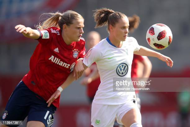 Carina Wenninger of Muenchen battles for the ball with Ewa Pajor of Wolfsburg during the DFB Cup Semi Final match between FC Bayern Muenchen and VfL...