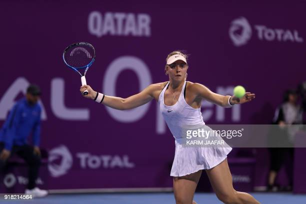 Carina Witthöft of Germany returns the ball to Caroline Wozniacki of Denmark during their singles second match at the 2018 WTA Qatar Open in the...