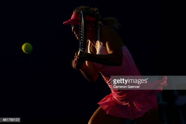 Carina Witthoeft of Germany plays a backhand in her first round match against Carla Suarez Navarro of Spain during day one of the 2015 Australian...