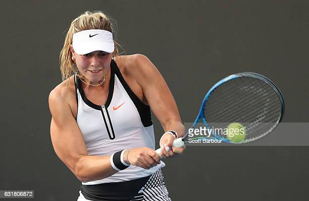 Carina Witthoeft of Germany plays a backhand in her first round match against Eri Hozumi of Japan on day one of the 2017 Australian Open at Melbourne...