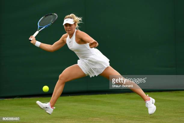 Carina Witthoeft of Germany plays a forehand during the Ladies Singles first round match against Mirjana LucicBaroni of Croatia on day one of the...