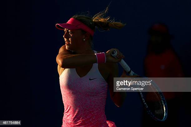Carina Witthoeft of Germany plays a forehand in her first round match against Carla Suarez Navarro of Spain during day one of the 2015 Australian...