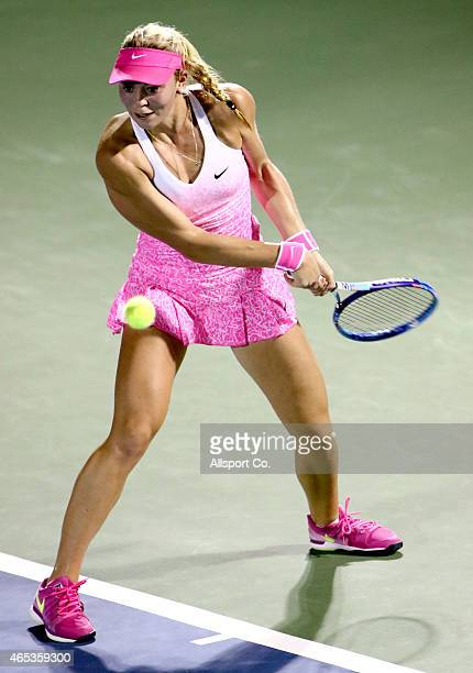 Carina Witthoeft of Germany plays a shot to Caroline Wozniacki of Denmark in the Quarter Finals during day five of the BMW Malaysian Open at the...