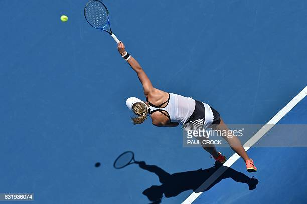 Carina Witthoeft of Germany serves against Angelique Kerber of Germany during their women's singles match on day three of the Australian Open tennis...
