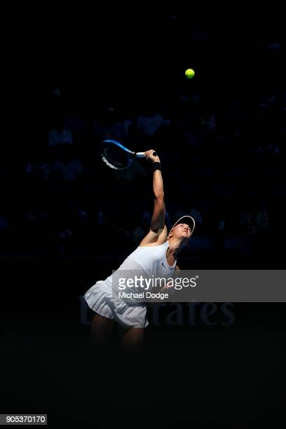 Carina Witthoeft of Germany serves in her first round match against Caroline Garcia of France on day two of the 2018 Australian Open at Melbourne...