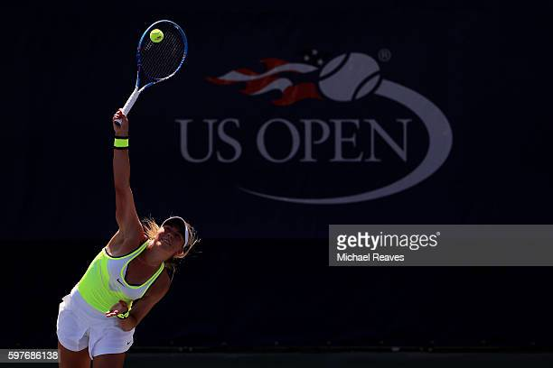 Carina Witthoeft of Germany serves to Misaki Doi of Japan during her first round Women's Singles match on Day One of the 2016 US Open at the USTA...