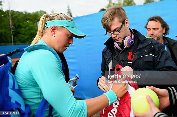 Carina Witthoeft of Germany signs autographs during Day Five of the Nuernberger Versicherungscup 2015 on May 20 2015 in Nuremberg Germany