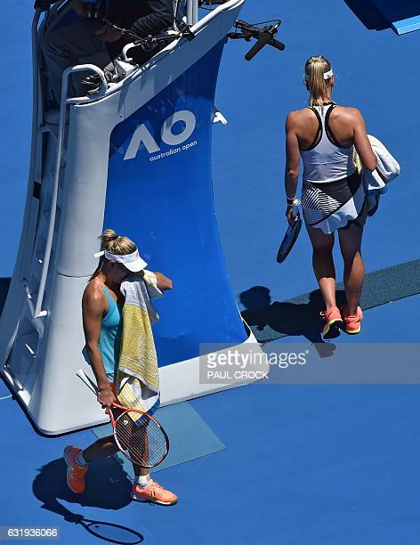 Carina Witthoeft of Germany walks past Angelique Kerber of Germany at the changeover during their women's singles match on day three of the...