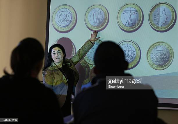 Carine Callus an information officer at the National Euro Changeover Committee teaches a class on the new currency in Attard Malta on Tuesday Dec 18...