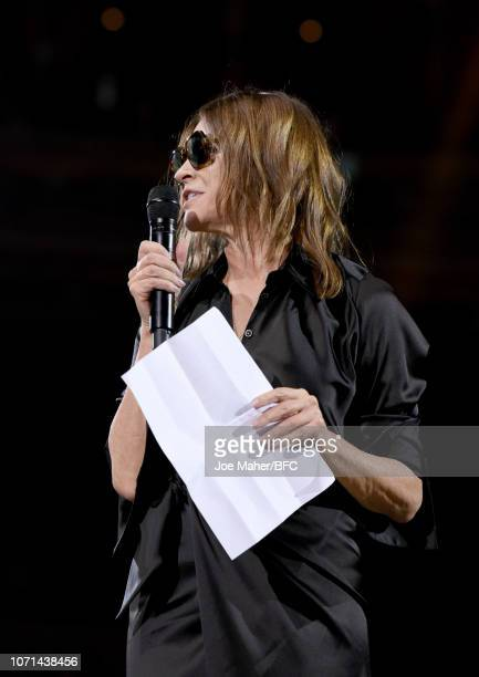 Carine Roitfeld accepts Demna Gvasalia for Balenciaga Accessories Designer Of The Year award during The Fashion Awards 2018 In Partnership With...
