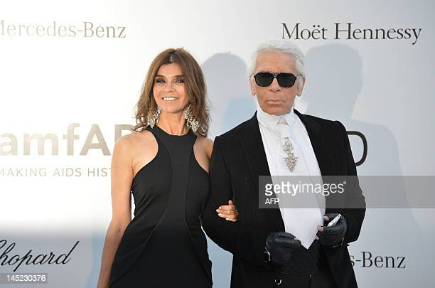 Carine Roitfeld and designer Karl Lagerfeld pose as they arrive to attend the 2012 amfAR's Cinema Against Aids on May 24, 2012 in Antibes,...