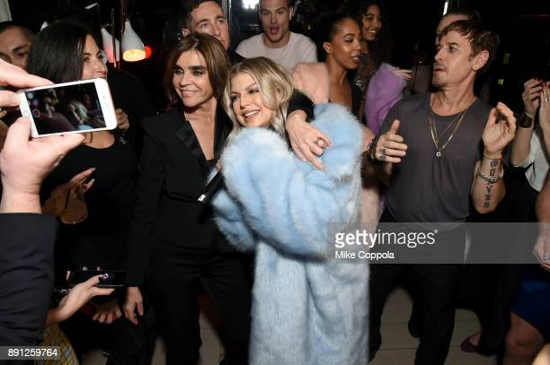 Carine Roitfeld and Fergie attend the CR Fashion Book Celebrating launch of CR Girls 2018 with Technogym at Spring Place on December 12 2017 in New...